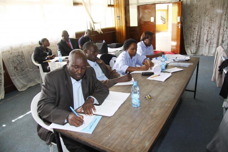 MR. STEPHEN NDEGWA TAKES NOTES ON ERM TRAINING