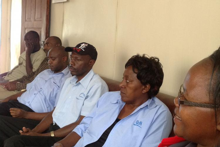 Mr. James, Mr. Silvester and Ms. Lilian during a visit to the children's home