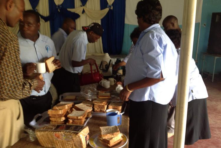 Mr. Peter Wanyoike and Mr. James Langi sharing some food