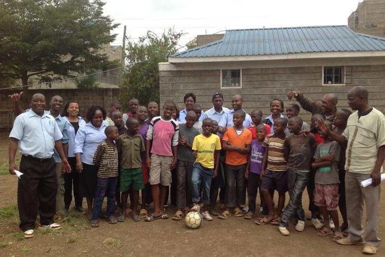 Mr. Peter Wanyoike and Ms Irene Mwihia and other auditors Posing for a photo with the children after the football match