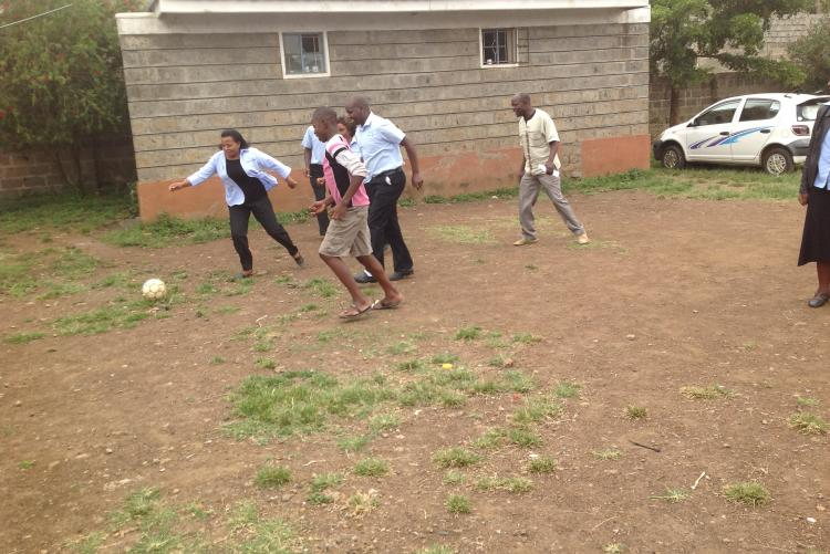 Ms Irene, Mr James and Mr. Henry shows the kids the art of playing football in Life Children Home