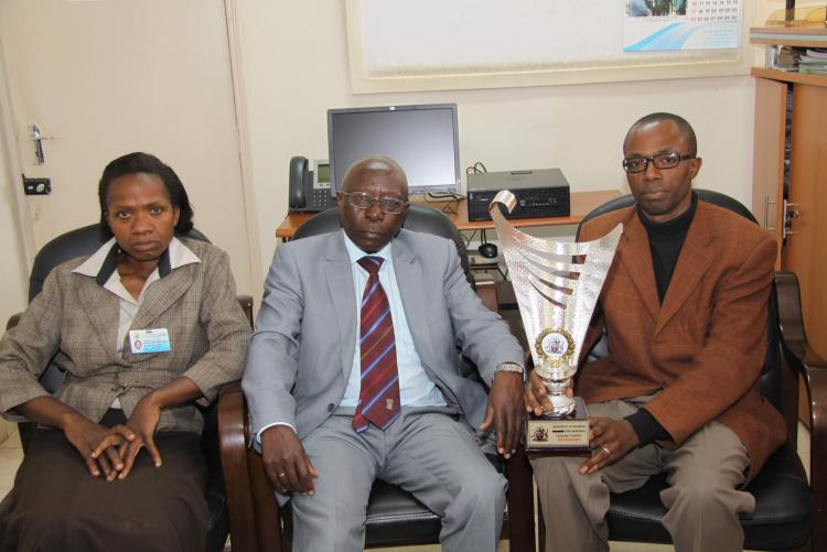 The CIA and Mr Muasya and their colleague posing with the trophy