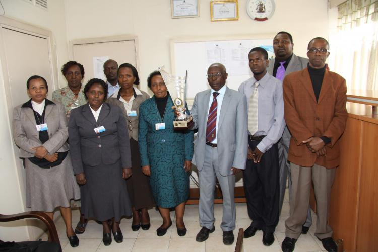 The Internal Audit staff posing with the trophy
